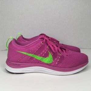 Nike flyknit lunar 1 pink and green neon sneakers.